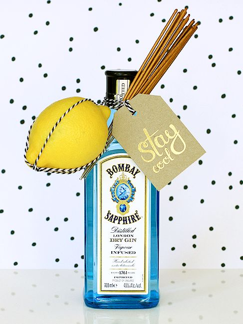 A fun gift idea for a holiday party - a bottle of gin, a lemon, and SPARKLERS! All tied together with Ritual's 'stay cool' gift tag.