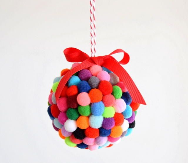 DIY Styrofoam Ball Christmas Ornament — Alex from Northstory made this pom pom ornament with her kids