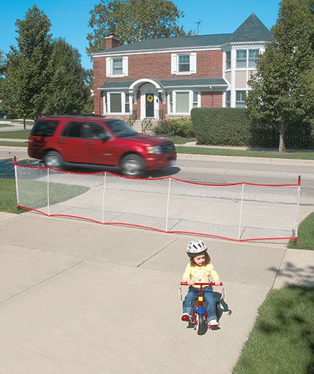 """Extendable Driveway Barrier  $29.95 each turns driveways, garages and lawns into safer play areas. Soft, retractable barriers create a visual boundary for kids and neighborhood traffic while keeping vehicles out of your driveway. Big enough to add protection to 2- and 3-car driveways,easily rolls up4storage&portability. Made of highly visible, water-resistant netting, the fence measures 36"""" tall&extends a full 20 feet wide. End poles feature stakes that push in2the ground4easy setup."""