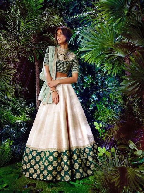 Sabyasachi is on a roll! check out this unconventional stunner for your sangeet - Stand out with its creme and emerald hues #indianwedding #bridalfashion #indianweddinginspiration #fashion #trends curated by Witty Vows - The ultimate guide for the Indian Bride | www.wittyvows.com