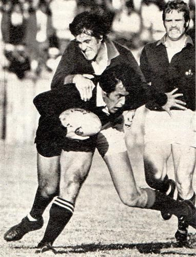 20 July 1976 - South African Gazelle 15 / All Blacks 21  Christo Wagenaar making a tackle on Bryan Williams with Cheeky Watson grinning in the background.