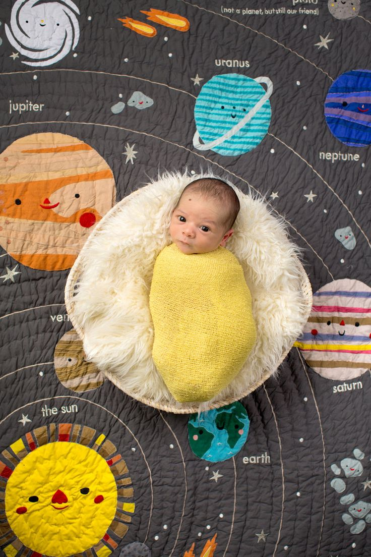 It doesn't get more adorable than this solar system themed newborn session! See more of this adorable face, photographed by Crystal Lee Photography, over on the blog!  NEWBORN PHOTOGRPAHY | Solar System Themed Nursery, Colorful Newborn Photos
