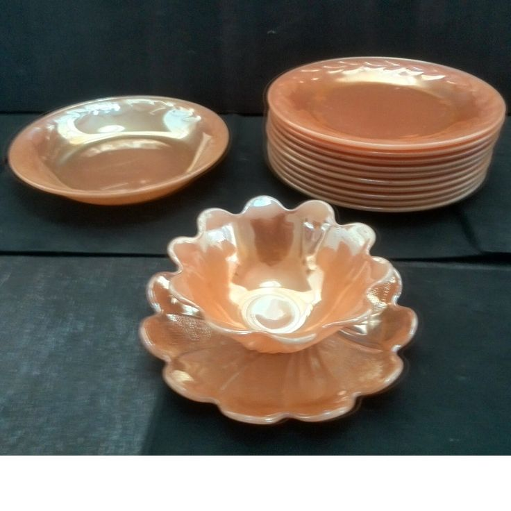 Please make an offer on these items.13 PCS. VINTAGE FIRE KING, ORANGE LUSTER WARE, 10 salad plates, 1 BOWL, 1 starter/desert dish with plate1940's