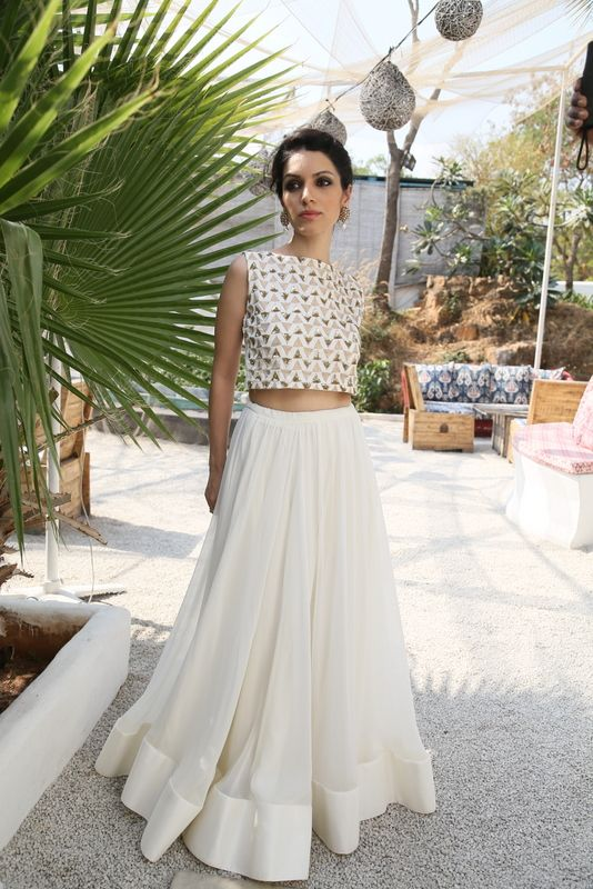 """DETAILS.  White triangles crop top, without lehenga. The back has a zip and the  outfit has sequins and zari work.Delivery 2-3weeks.  SIZE & MATERIALS.  S - Bust 34"""", Under bust 28 """", Length14"""" M - Bust 36"""", Under bust 29"""", Length 14""""  Custom sizing available.  Satin cotton."""