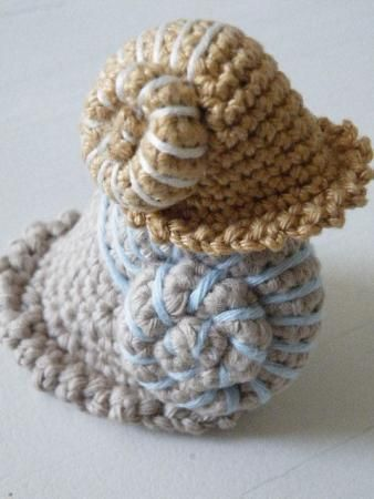 crochet snail shells. Pattern for sale and not in English, but I think I can figure it out.