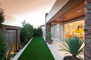 """Mixing """"live"""" plants with an artificial turf base is great for saving time on maintenance and water usage for the turf."""