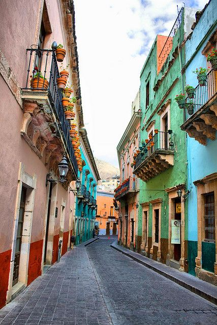 Street in Guanajuato, Mexico   Oh to live in one of these houses and balcony see the morning sun from the balcony....