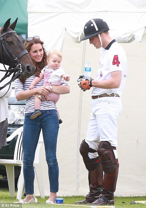Daddy's boy: Prince George makes a grab for his father's water on Father's Day on June 14, 2014 at a Polo Match