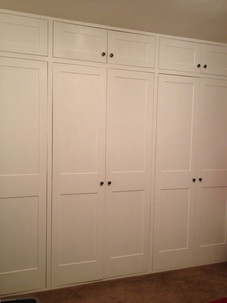 Shaker style wardrobe doors for built in wardrobes across the width of a bedroom www.bmc-construction.co.uk