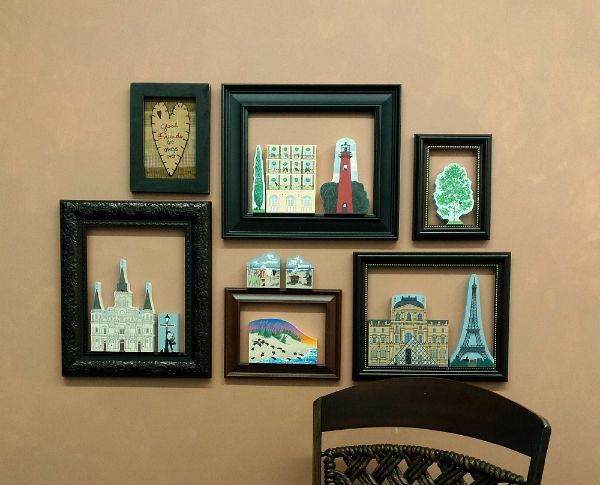 Do you have some old picture frames laying around?  Put them to use in a unique way displaying your favorite Cat's Meow shelf sitters..