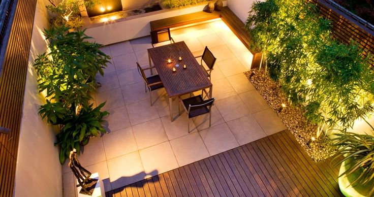 concrete, wood decking, planters and uplighting