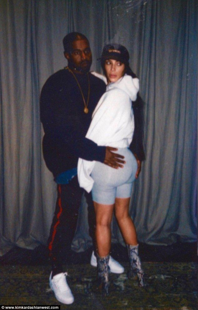 More than a handful: Kim Kardashian shared this snap of her with husband Kanye West to her website on Tuesday