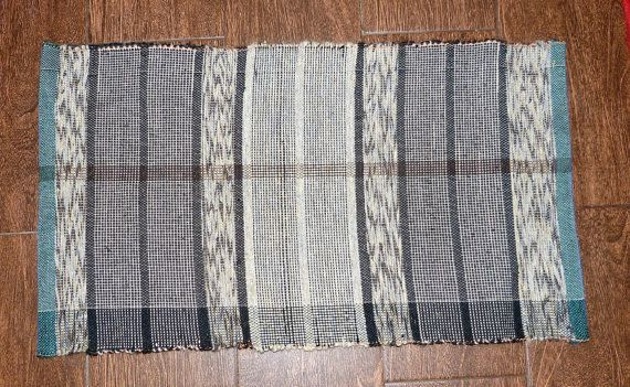 Mat hand made. Hand weaving. Rug wool 100%. Decorative element in your home. Rug with stripes. Mat gray. This beautiful rug was hand woven on my loom. Very decorative element in Your home that will give You joy, warmth and comfort.  Measures: 40 cm x 73 cm.  15,7 inch x 28,7 inch.