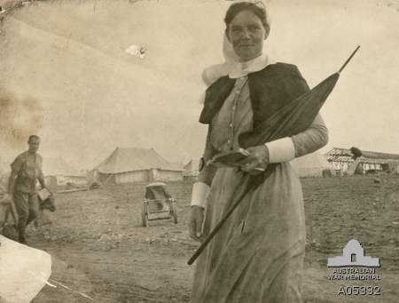 """Matron Grace Wilson doing her rounds on Lemnos, 1915. Matron Grace Wilson arrived on Lemnos in early August, just days after learning of the death of her brother, Graeme, shot by a Turkish sniper on Gallipoli three months earlier. As casualties began to arrive, she was appalled by the lack of equipment and conditions """"too awful for words""""."""