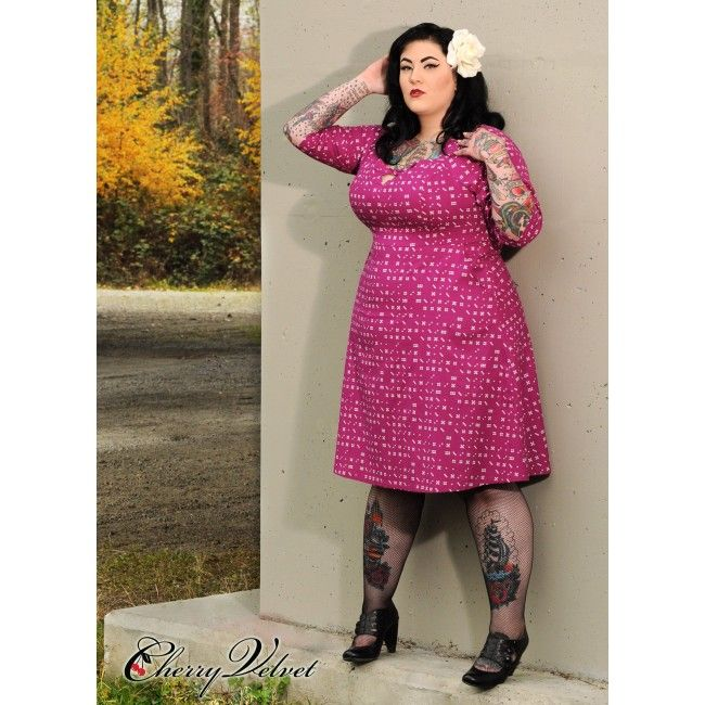 Rita dress in Plum domino print - Rita is poised to make you fall for her quicker than a domino in a lineup! With a flirty peep-tie neckline, three-quarter length sleeves, and knee length A-line skirt, this dress is a SCORE. - See more at: http://www.sweetechoplus.com/dresses/cherry-velvet/rita-plum-domino-dot.html   #Rockabilly #SweetEchoPlus #PinUpFashion #PinUp #BBWFashion #CurvyGirl