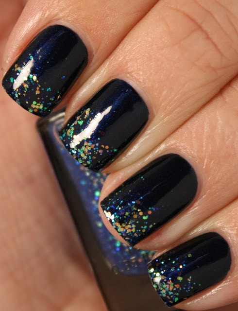 I love dark blue polishes. The midnight blue shimmer base looks just like the paint on my car!
