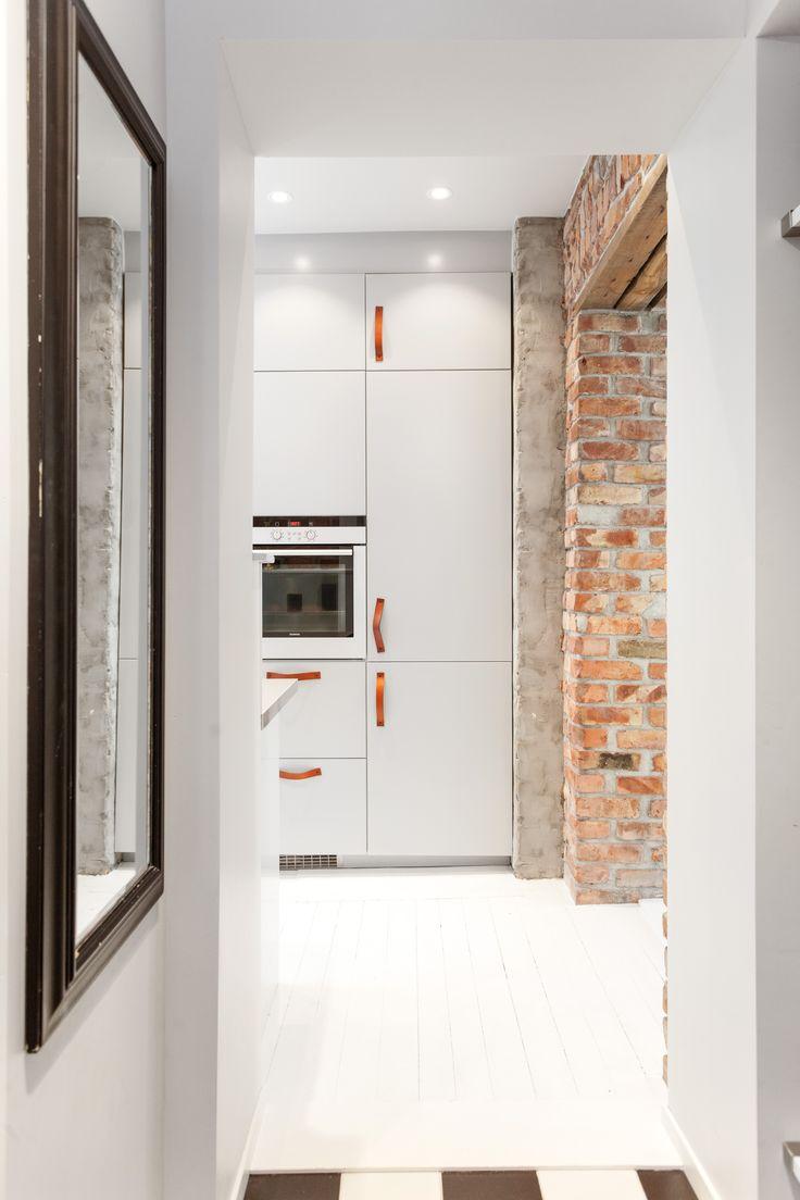 Leather handles, brickwall, kitchen. Architect/designer, Lisa Wettsjö+Gustav Wettsjö