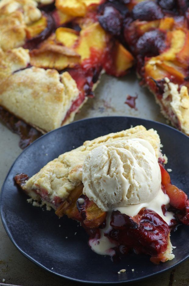 Summer Stone Fruit Galette. Sweet, juicy peaches, plums and cherries with brown sugar and a hint of vanilla over a buttery vegan crust.