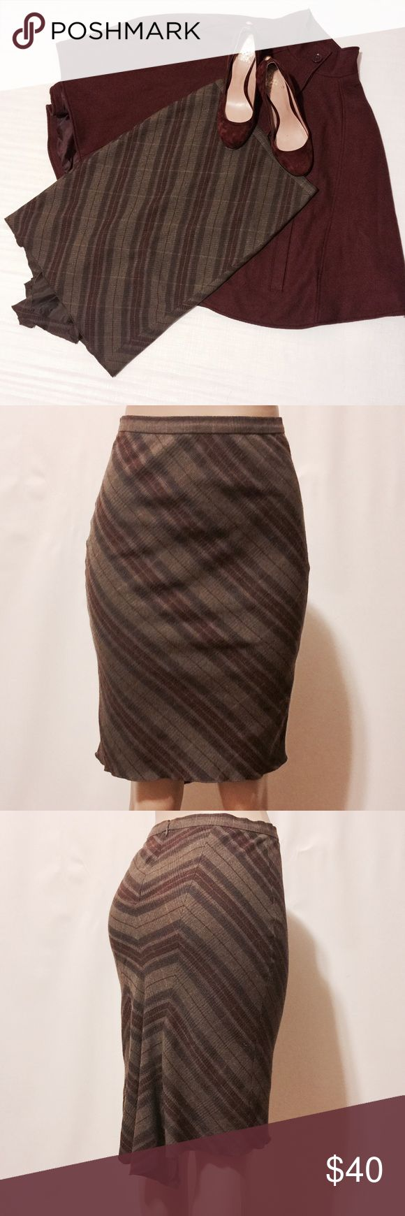 "BCBGMAXAZRIA Wool Plaid Fitted Bias Skirt Sz 0 Amazingly sexy! Olive, plum and tan bias plaid skirt. Fitted with back trumpet pleat for that extra pizzazz. FITTED! 3/4"" rigid waistband with center back invisible zipper closure. 53% Wool 44% Cotton 3% Other 100% Acetate lining Dry Clean Only 28"" Waist 34"" Hips 42"" Sweep 24"" Overall length #TH0701016 BCBGMaxAzria Skirts Midi"