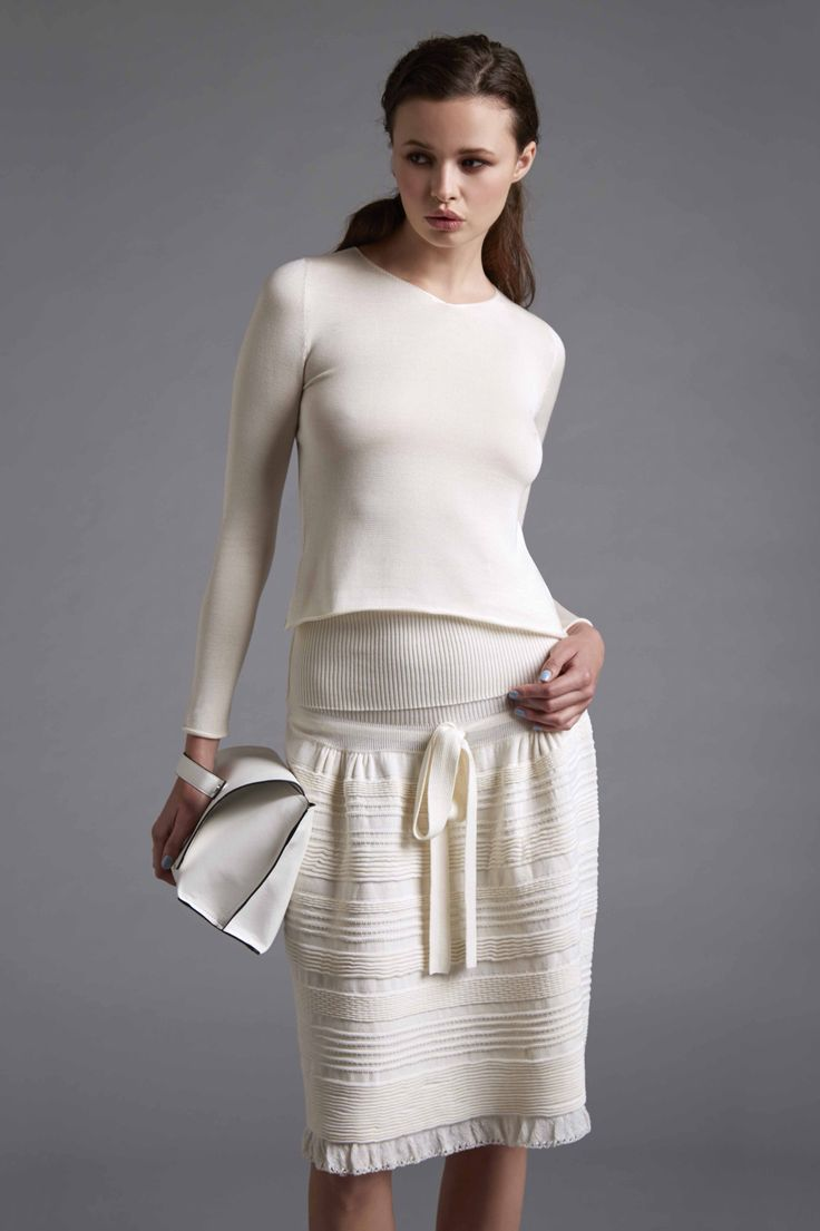 V-Neck sweater. Skirt Made with mixed tecniques points