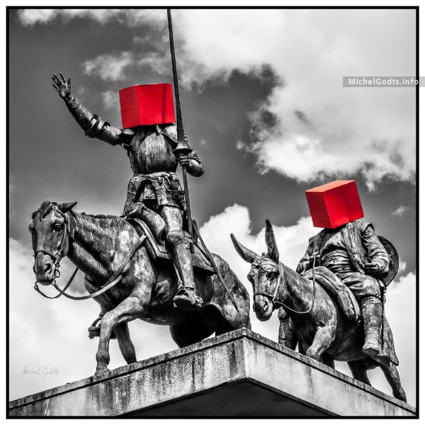 The statue of Don Quixote and Sancho Panza, Place d'Espagne in Brussels, Belgium, with faces concealed by bright red boxes. Signed or unsigned original photograph for art collectors or for an urban wall decor.