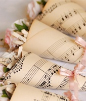 Check out @VintageTwee for gorgeous vintage-inspired table decor. This would be lovely using music from your ceremony.