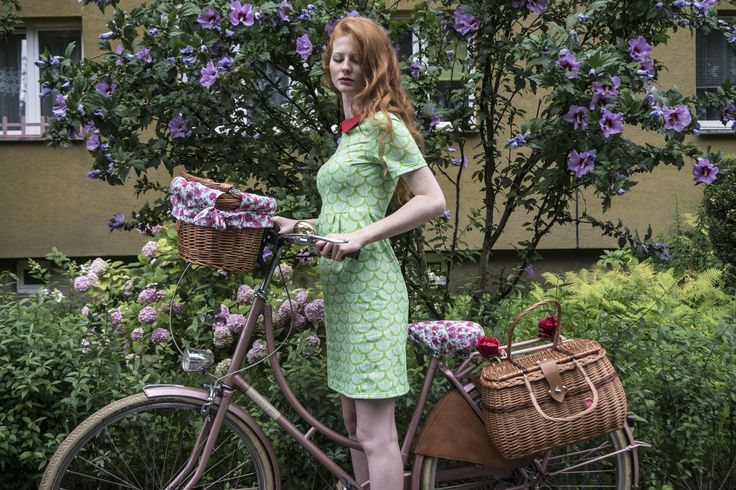 Red head girl with colorful bike equipment