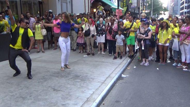 BRAZILIAN GIRL DOES A WILD STREET SAMBA MUSIC PUNTA DANCE AT THE 2016 BR...