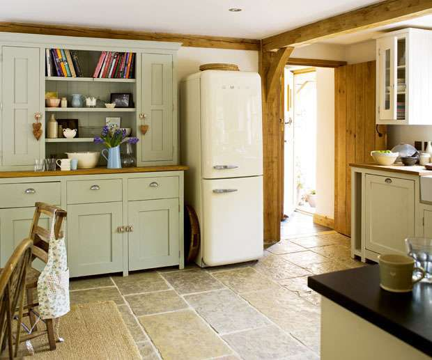 Country Homes and Interiors kitchen with Smeg fridge. Modern Country Style: Smeg Fridges Click through for details.
