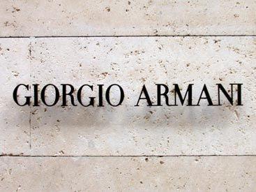 Giorgio Armani Brand architecture _ Times Roman font on travertine