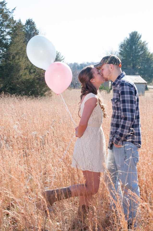 LOVE this.  Or even  have a tree in the background with pink and blue balloons tied all through it.