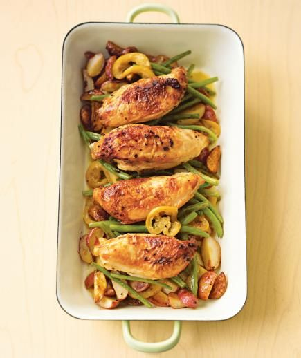 Pan-Roasted Chicken With Lemon-Garlic Green Beans: The only thing better than a one-dish dinner is a well-rounded one-dish dinner. In this easy recipe, chicken breasts bake atop a bed of quartered potatoes and green beans. A light dressing of lemon, garlic, and olive oil lend bold, bright flavor to the entire dish.