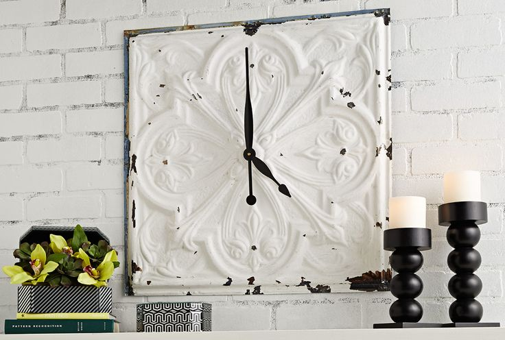 Repurpose an antique tin ceiling tile as the backer for a DIY wall clock. The process of adding the clock movement and hands couldn't be easier.