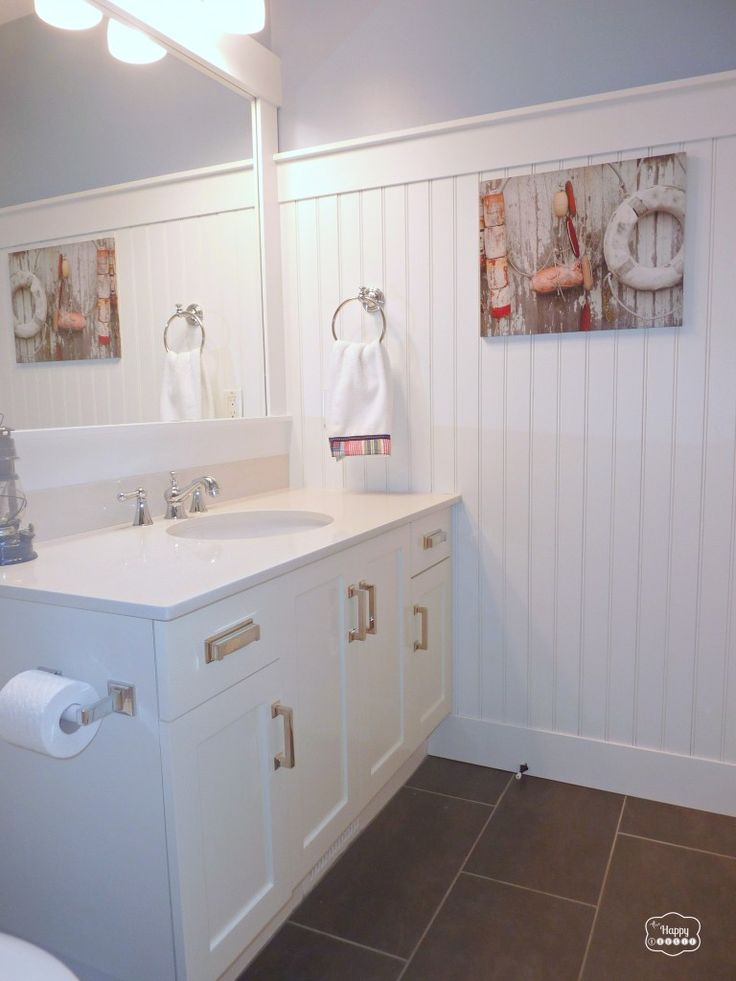 Love the cabinet hardware - How to Update Your Bathroom on a Budget at The Happy Housie 2