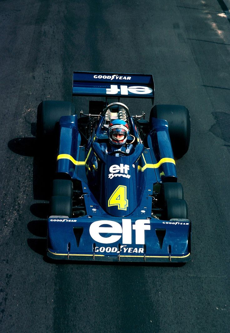 f1pictures:  Patrick Depailler  Tyrrell - Ford 1976.  The famous 6-wheeled ELF.  It was great to  watch.  Innovation, the essence of F1.