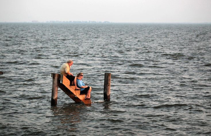 Hurricane Irene: Billy Stinson comforts his daughter Erin Stinson as they sit on the steps where their cottage once stood on August 28, 2011 in Nags Head, N.C. by Scott Olson via boston.com