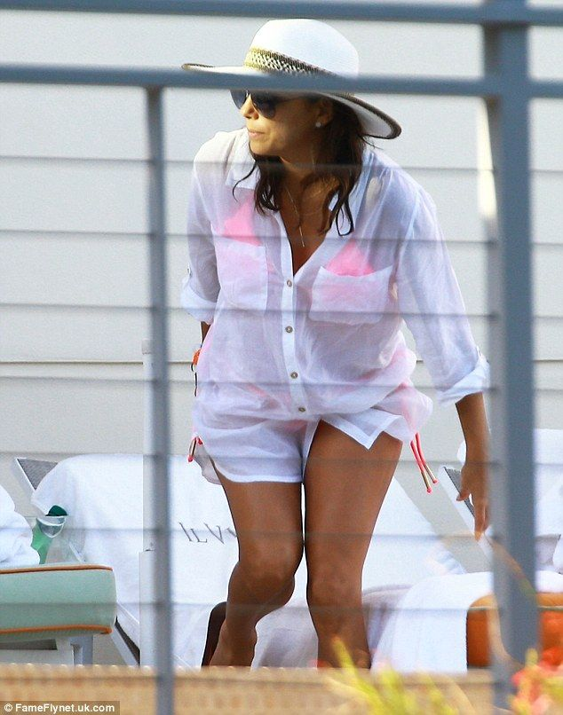 Pretty in pink: The Latina beauty was spotted in a fuchsia bikini which she covered up wit...