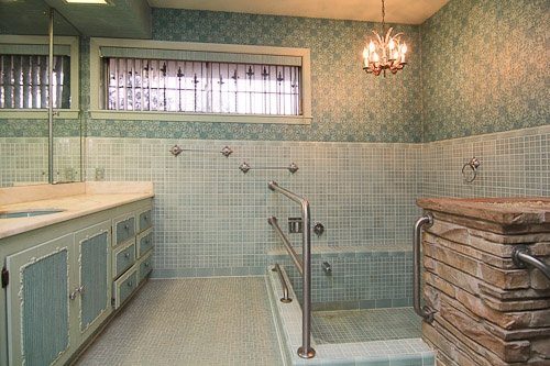 A sunken tile bathtub. Original mid-century bathroom. Divine!