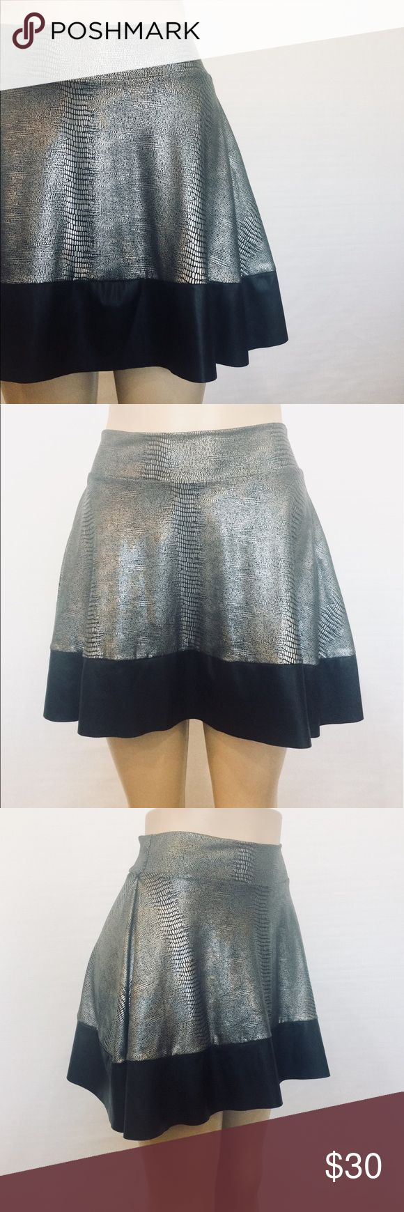 "⭐️ Metallic Snake Print Knit Skater Mini Skirt Grey, Pewter and Black Snake Print. Pull on waistband, fit and flair mini. Liquid knit, supper stretchy. 85% Nylon 15% Lycra Machine Washable 23"" Waist 72"" Sweep 16"" Overall Length Skirts Circle & Skater"