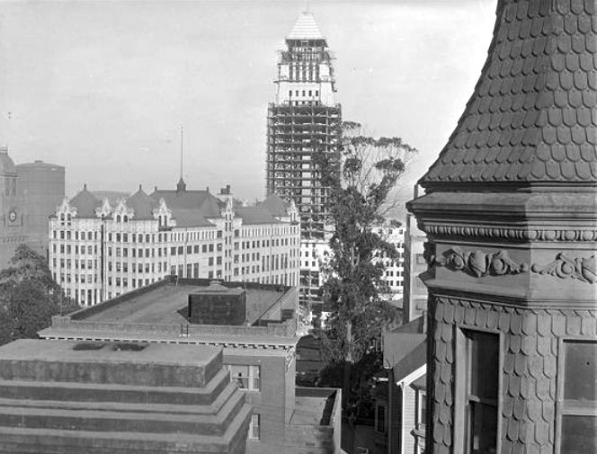 Here's an unusual angle we don't often get to see. It's the view looking east from the Bradbury Mansion widow's walk, while Los Angeles City Hall was being built in 1928. Lewis L. Bradbury was hugely successful real estate developer who built a magnificent home on Hill Street. (He also built the famous Bradbury building) As we can see from this photo, he had quite the view. But I wonder if he thought that the rise of the tallest building in LA spoiled his view.