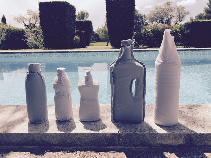 Textile covered handsewn used plastic bottles by Baetenmaes!
