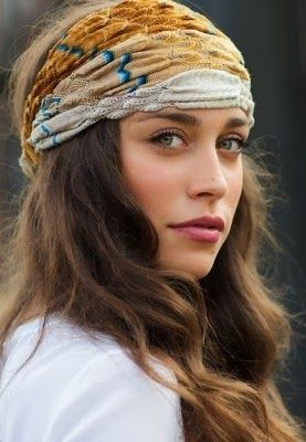 Nothing about the looks of this girl fits Gita, but she wears a similar sort of headwrap.