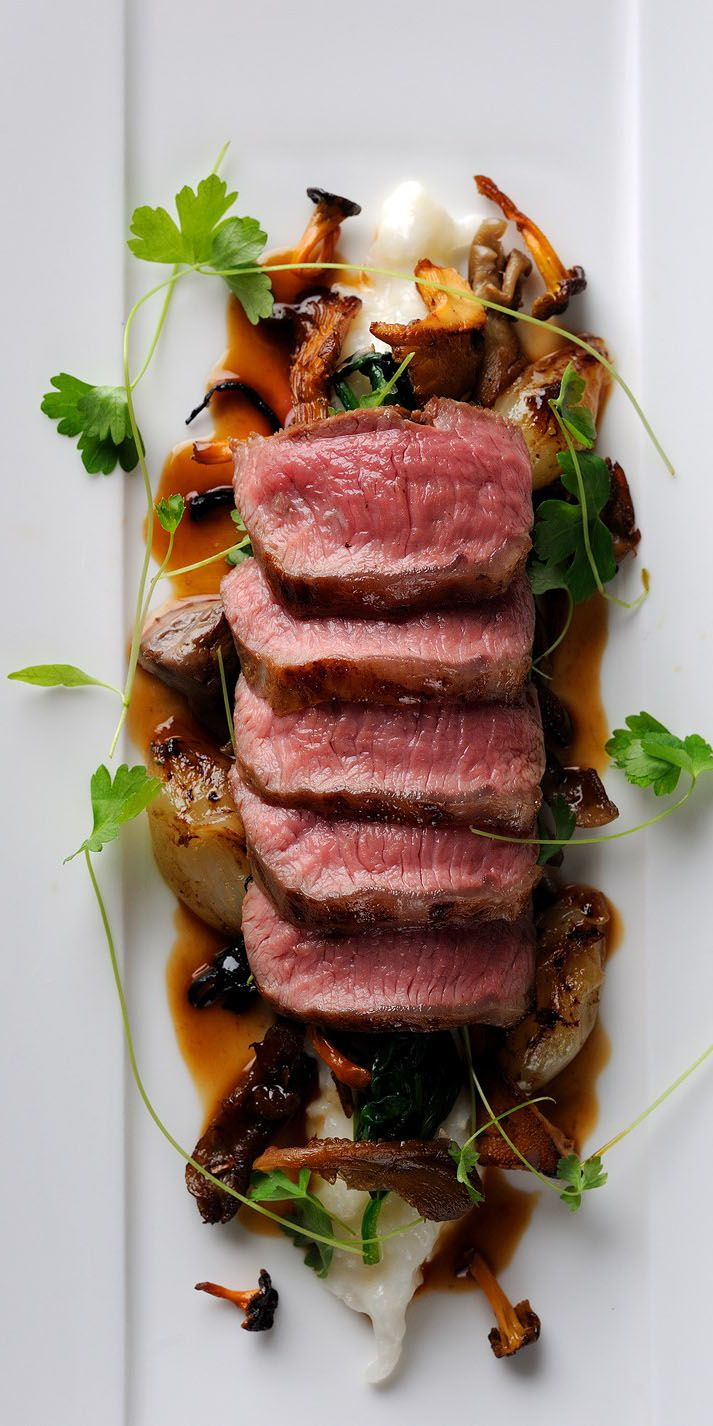 This exceptional lamb loin recipe from Chris Horridge features a wonderful combination of elements, with blushing lamb served on a bed of creamy Parmesan risotto and wilted spinach, finished off with roast shallots, wild mushrooms and olives.