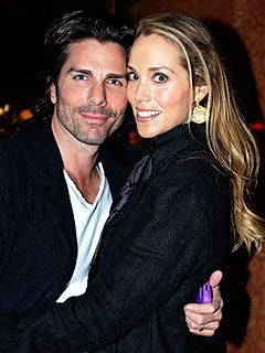 Elizabeth Berkley and husband Greg Lauren- expecting a baby this Summer.  Aren't they a nice looking couple?!