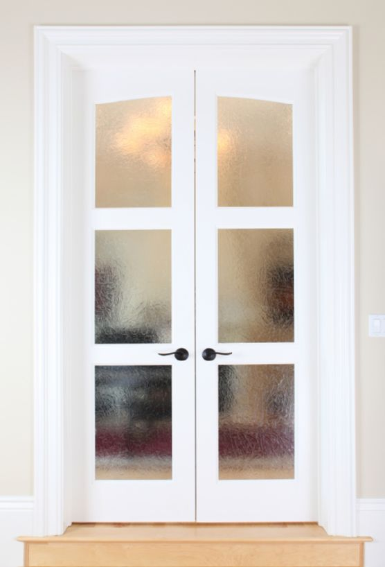 Frosted glass french doors as seperators for bedroom/dressing room.