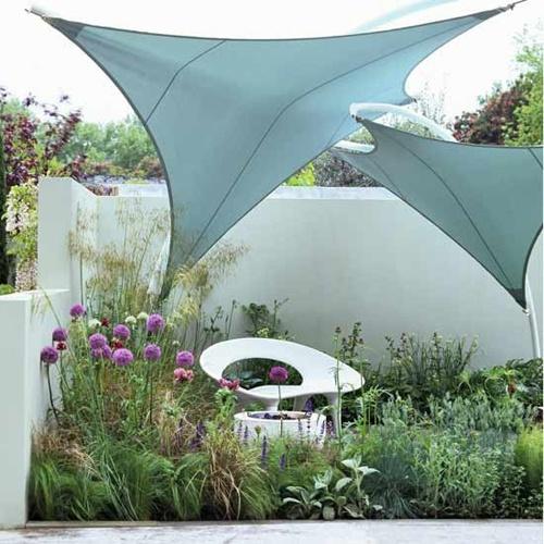 beach themed garden from house to home sails by crocus http - Beach Style Garden Ideas