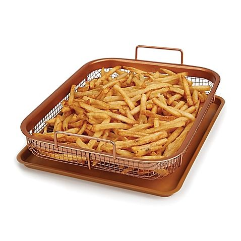 Instantly turn your oven into an air fryer with the convenient 2-Piece Copper Crisper Oven Air Fryer Pan Set. Simply add your dish to this crisper pan, put into the oven, and enjoy your favorite fried foods without the oil or mess.