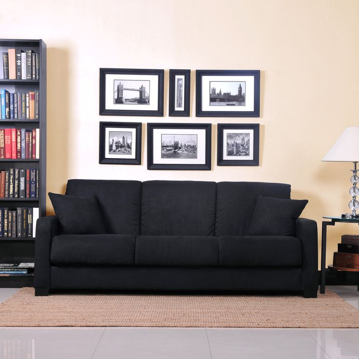 Comfortable and stylish, the transitional convert-a-couch features squared arms and converts into a full size bed with the touch of a hand. The futon sleeper sofa is covered in a durable black microfiber and works well in any decor.