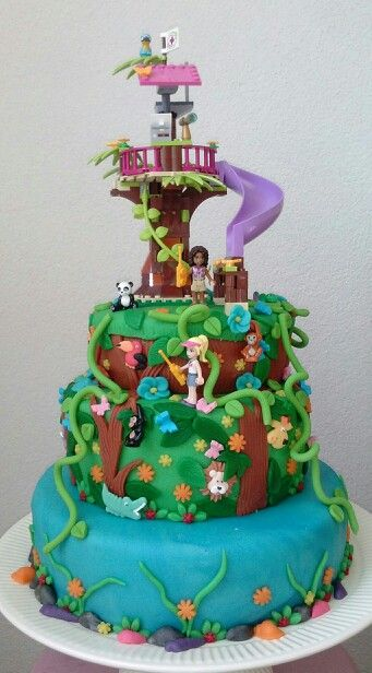 Amazing cake!! I think the tree and slide on top is actually Lego - I recognise the slide. If you have any Lego set to put on top I could incorporate it into an amazing cake, something like this would be £110 for 3 tier, £80 for 2 tiers and £50 for a single tier. There's masses of detail in this though with all the jungle characters etc so it's a bit time consuming.