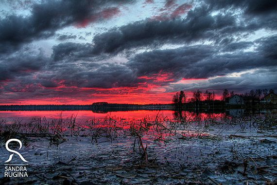 Red sunset in Finland over a lake surreal by behindmyblueeyes
